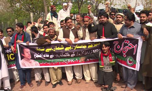 PTI workers stage demonstration outside Imran Khan's Bani Gala residence