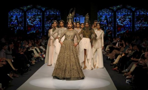 Models present creations by Pakistani designer Fahad Hussayn during the Fashion Pakistan Week (FPW) in Karachi April 1, 2015. Reuters