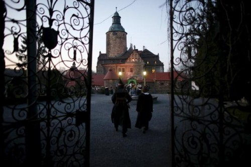 Participants walk as they wait for the beginning of the role play event at Czocha Castle in Sucha, west southern Poland April 9, 2015.