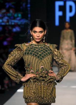 A model presents a creation by Pakistani designer Fahad Hussayn during the Fashion Pakistan Week (FPW) in Karachi April 1, 2015. Reuters