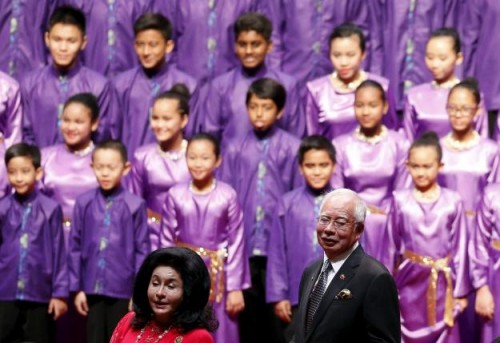 Malaysia's Prime Minister Najib Razak (R) and his wife Rosmah Mansor at the opening ceremony of the 26th ASEAN Summit in Kuala Lumpur, Malaysia,