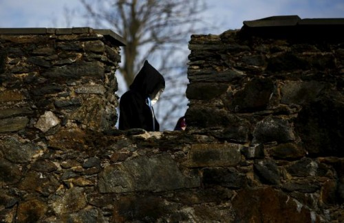 A participant walks near a castle defense wall before the role play event at Czocha Castle in Sucha, west southern Poland April 9, 2015.
