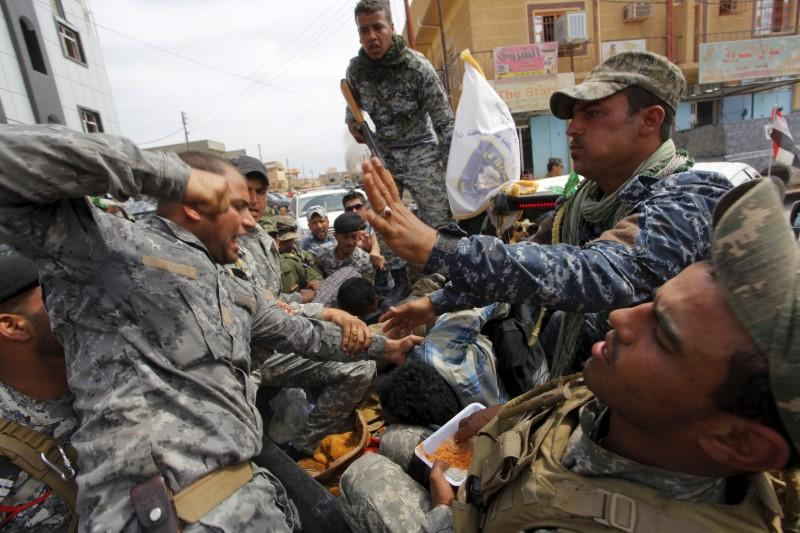 After Iraqi forces take Tikrit, a wave of looting and lynching