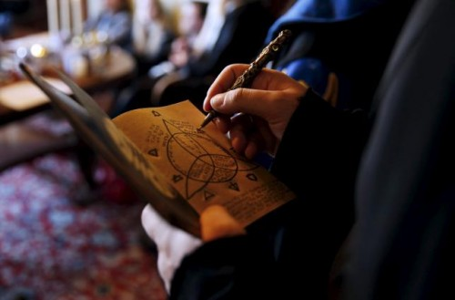 A participant draws on his 'secret book' during a workshop before the role play event at Czocha Castle in Sucha, west southern Poland April 9, 2015