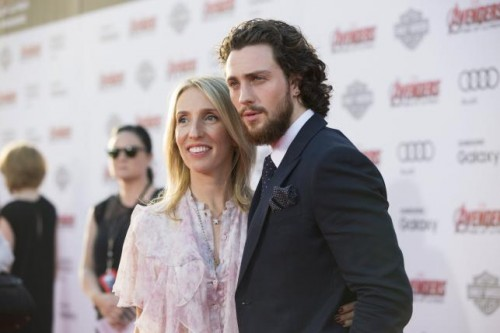 Cast member Aaron Taylor-Johnson and his wife Sam pose at the premiere of 'Avengers: Age of Ultron' at Dolby theatre in Hollywood, California April 13, 2015.