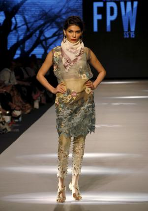 A model presents a creation by Pakistani designer Sanam Chaudri during the Fashion Pakistan Week (FPW) in Karachi April 1, 2015. Reuters