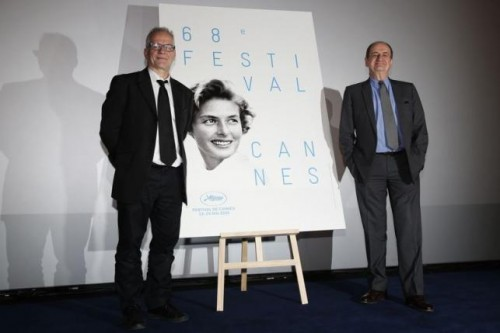 Cannes Film festival general delegate Thierry Fremaux (L) and its president Pierre Lescure pose near this year's poster after a news conference to announce the competing films at the 68th Cannes Film Festival in Paris April 16, 2015.