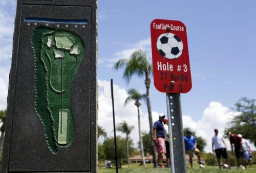 People stand at the FootGolf course at Largo Golf Course, which runs alongside the regular golf course, in Largo, Florida