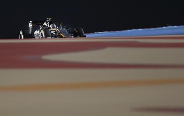 Motor racing: Hamilton wins again under Bahrain floodlights