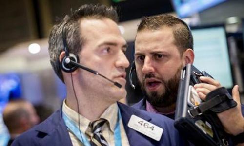 Wall St. drops but S&P, Nasdaq register quarterly gains