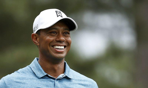 Woods shows flashes of old form on Masters practice day