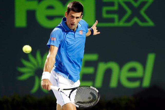 Djokovic through to face Isner in Miami semis