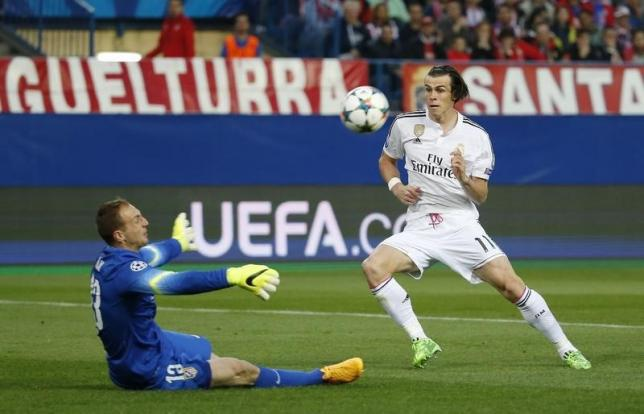 Oblak saves Atletico from dominant holders Real