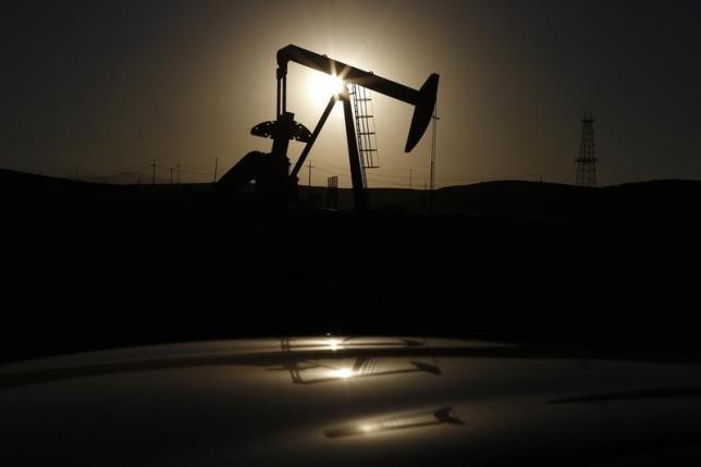 Oil down on US stock build, record Saudi output