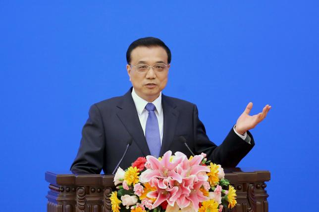 Chinese premier pledges support for firms to 'charge out into the world'