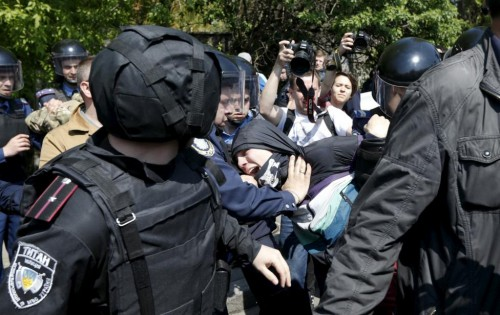 A man who tried to disrupt a May Day rally of Communist party supporters is detained by police in Kiev, Ukraine May 1, 2015. REUTERS