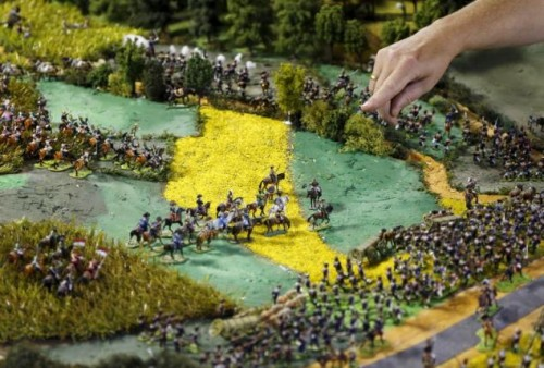 Waterloo enthusiast Smout points at a figurine representing French Emperor Napoleon on a 40-square-metre miniature model of the June 18, 1815 Waterloo battlefield, in Diest