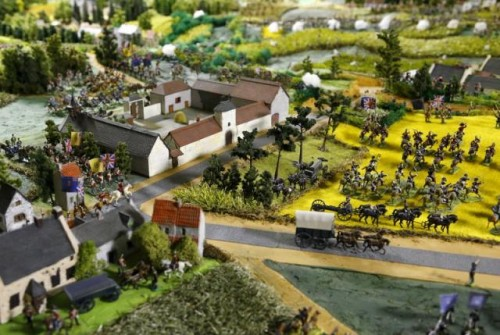 The Mont-Saint-Jean farm is seen near figurines representing soldiers of the British army on a 40-square-metre miniature model of the June 18, 1815 Waterloo battlefield, in Diest