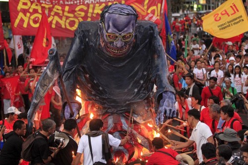 Workers burned an effigy of Philippine President Benigno Aquino during a May Day protest outside the presidential palace in Manila, Philippines May 1, 2015. REUTERS