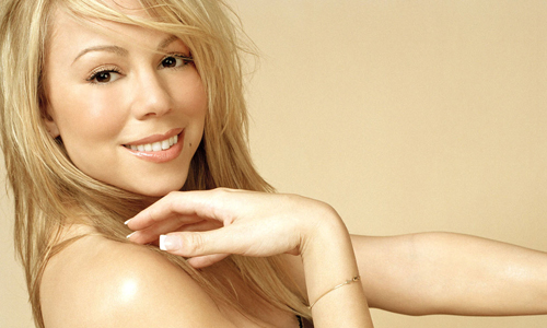 Fairground rides and butterflies as Mariah Carey opens in Las Vegas