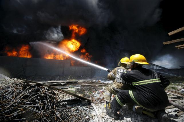 Slipper factory fire kills 31, dozens missing in Manila