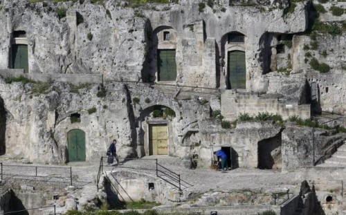 Men are seen outside Matera's Sassi limestone cave dwellings in southern Italy.