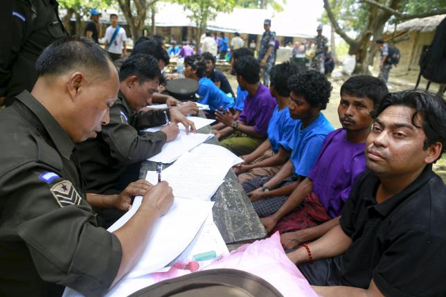 Myanmar navy claims rescuing Rohingya Muslims found on boat