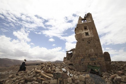 Man walks to a house that was damaged during an airstrike carried out by the Saudi-led coalition in Faj Attan village, Sanaa, Yemen
