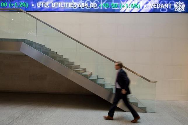 Fed keeps lid on dollar, yields; Greece hurts stocks