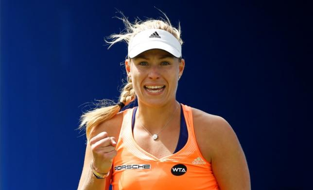 Kerber claims first grasscourt title