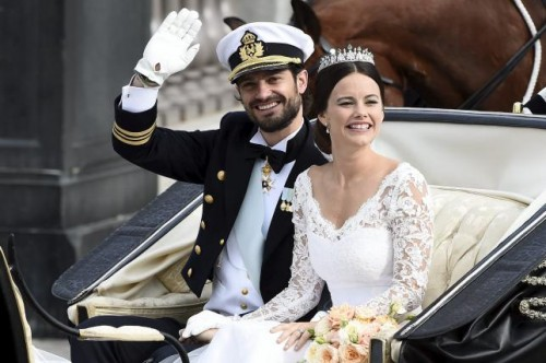 Swedish Prince Carl Philip and Sofia Hellqvist smile in the carriage during their wedding in the Royal Chapel in Stockholm