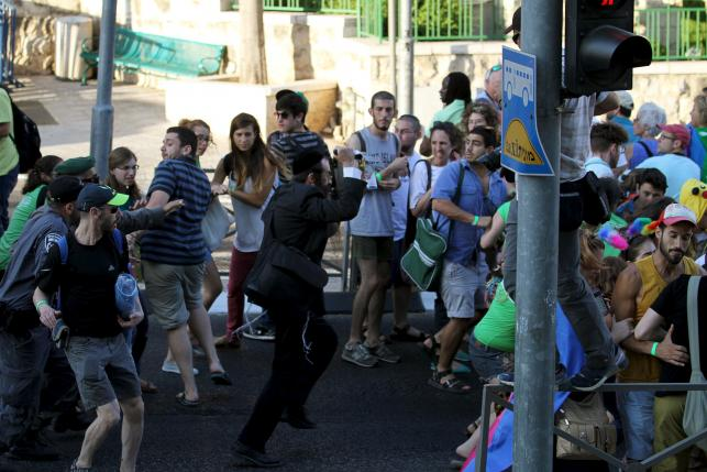 Religious assailant attacks Jerusalem parade, wounding six