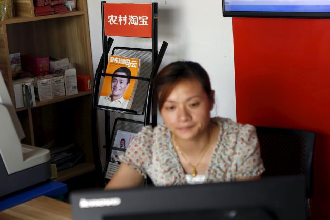 In rural China, shoppers go online - with a little help
