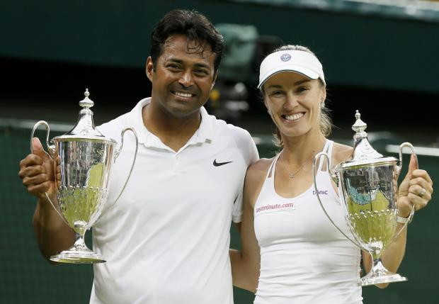 Double the joy for Hingis as she and Paes win mixed title