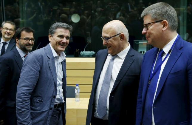 Euro zone demands more from Greece, delays decision on aid