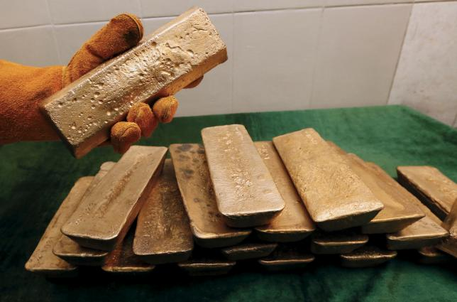 Gold holds near $1,170; Greece, dollar eyed for cues