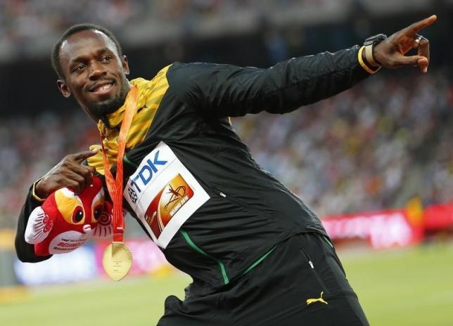 Bolt on track for more gold after Jamaica lead relay qualifiers