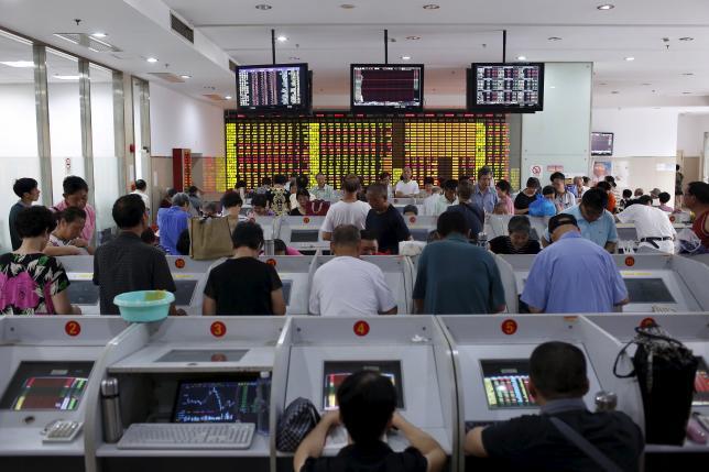 China, Hong Kong stocks fall on fears Beijing will let yuan weaken further