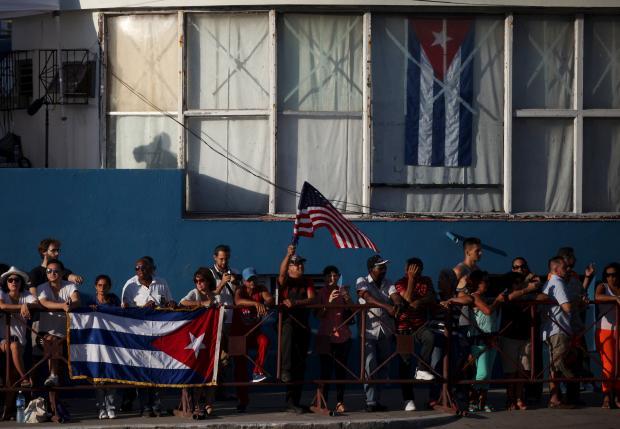 Kerry urges 'genuine democracy' in Cuba as US raises its flag