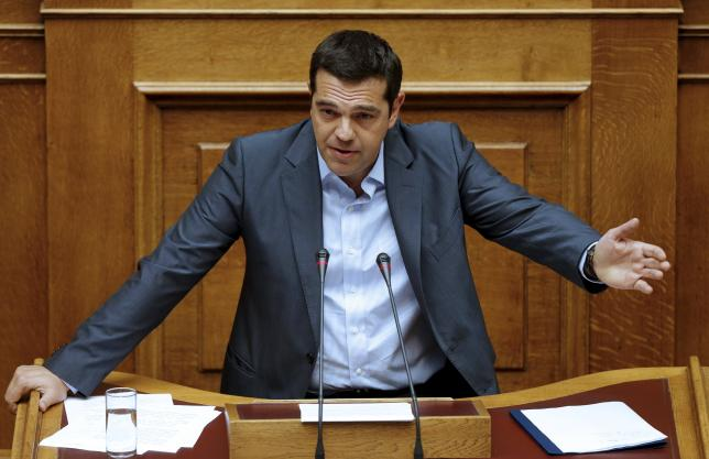 Greek PM Tsipras wins bailout vote, faces widening rebellion