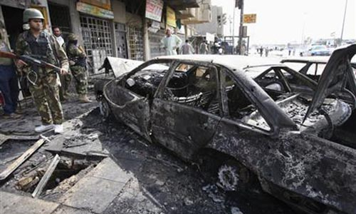 At least 71 people killed in two bomb attacks in Iraq