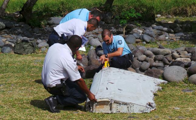 Australia says initial MH370 debris drift models gave wrong clues
