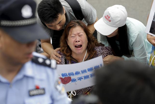 Malaysia seeks help, France widens search for missing plane