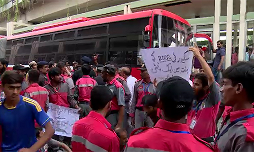 Metro Bus Service employees protest against blockage of salaries for two months in Lahore