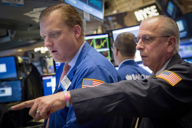 Global stocks end week lower, bruised by China yuan weakness