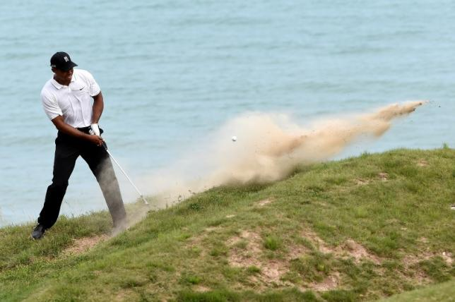 Struggling Woods misses cut at third major in a row