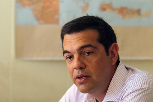 EU officials note progress in Greek bailout talks, deal possible next week