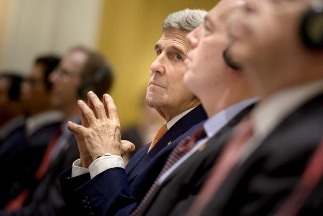 Kerry says US ties can grow if more freedom in Vietnam