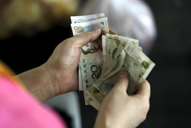 China's yuan slips even as central bank sets firmer midpoint