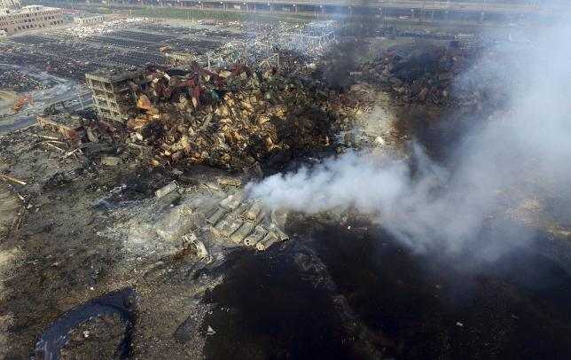 Rescuers work to clear China blast site of chemicals before rain falls